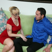 Alana Evans rubs the crotch of a younger man with her fingers grasping for cock
