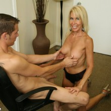 Erica Lauren has her tits played with by a young man