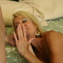 Erica Lauren massages a young cock in her hands