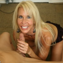 Erica Lauren smiles as she strokes a young man