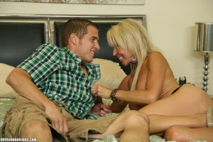 Erica Lauren starts to undress her grandson's friend
