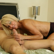Erica Lauren tugs on a hard young cock