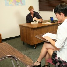 Ivy Reins sits in class wearing a short schoogirl's skirt