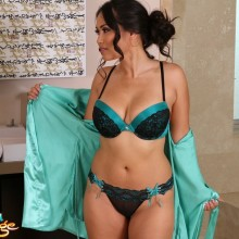 Jessica Bangcock unties her robe showing her bra and panties