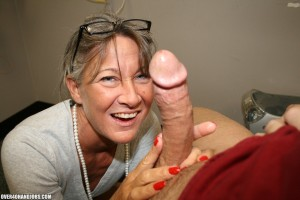 Leilani Lei stares at a cock with lustful eyes while giving it a hand job