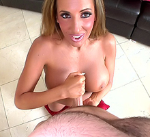 Richelle Ryan on her knees stroking a dick
