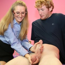 Sara James cups a set of balls while stroking a hard dick