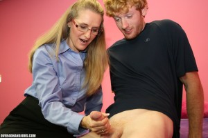 Sara James grips her student's cock in her hand