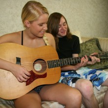 Vanessa Cage showing panties as she plays the guitar