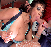 Persia Monir sticks a younger man's cock in her mouth