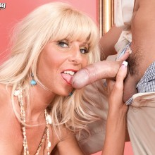Stormy Lynne licks the cock of the young waiter