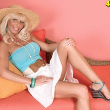 Stormy Lynne shows off her legs in a short white skirt