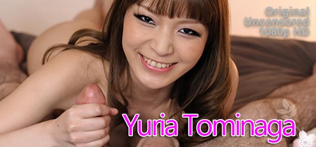 Yuria Tominaga gives a handjob in bed