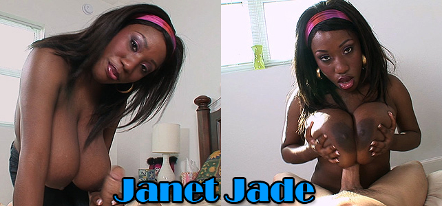 Janet Jade uses her black hands to stroke a white cock