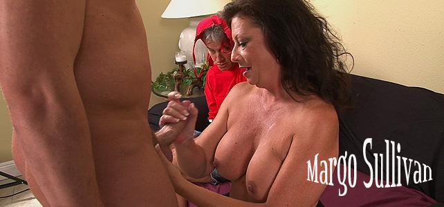 Busty-pornstar-Margo-Sullivan-jerking-cock-infront-of-cuckold-hubby