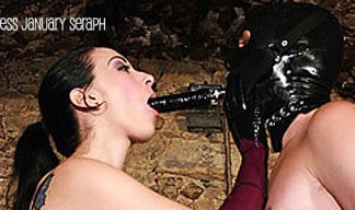 sexy mistress fucks her slave's mouth with a long toy