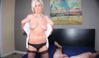Payton Hall takes off her shirt to reveal small milf titties