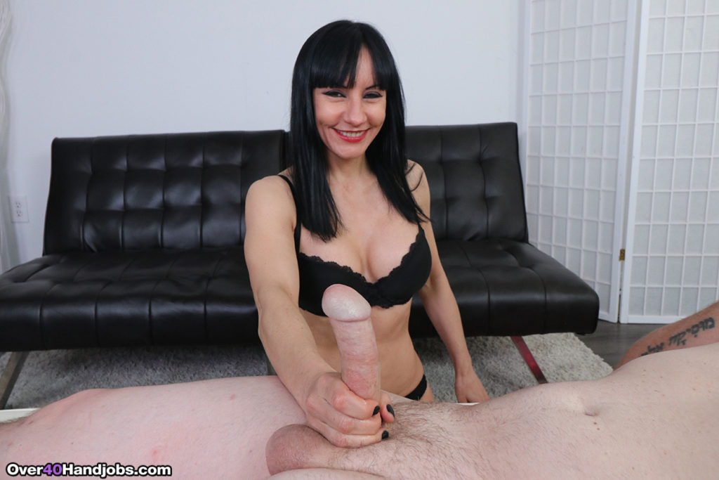 Super cute mature woman giving handjob